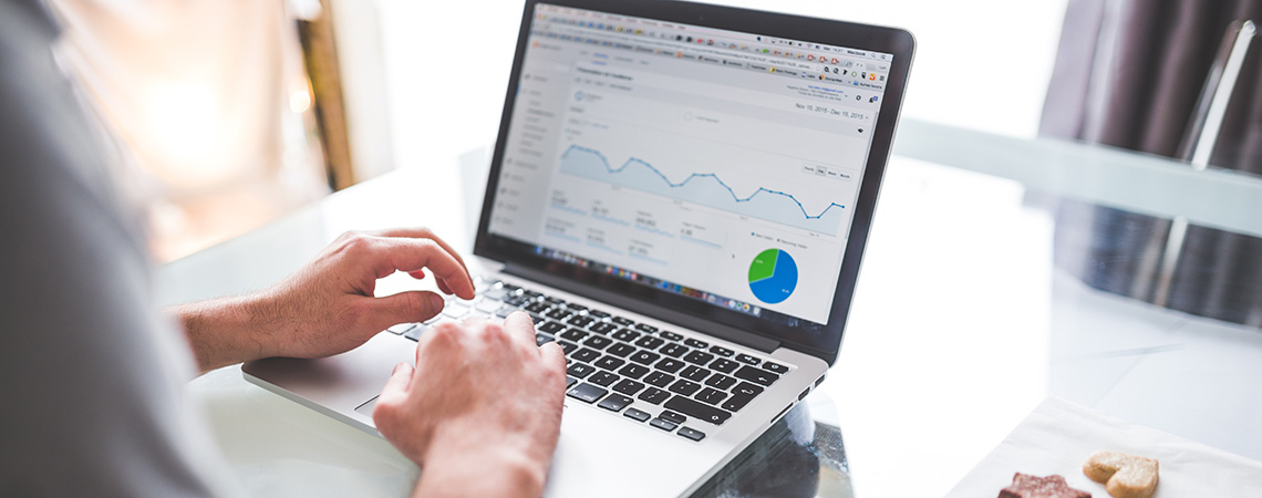 Man analyzing his site's analytics
